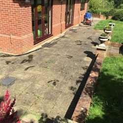 Before we pressure washed a patio area, Copdcok near Ipswich