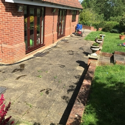 Patio area and red brick wall before cleaning, Copdock, Ipswich, Sufffolk