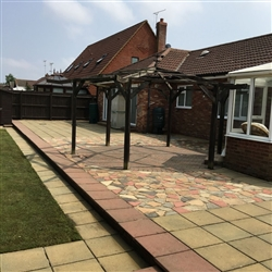 Patio area with coloured slabs after cleaning, Bixley Farm, Ipswich, Suffolk
