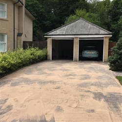 We have to ensure that weather conditions are dry before sand is applied to driveway